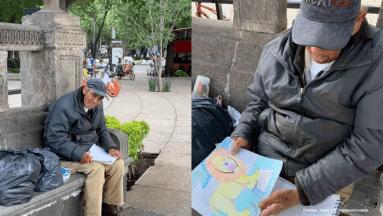 ¡Conmovedor! Anciano se gana la vida haciendo dibujos en CDMX; piden ayuda