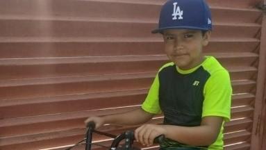 Ivancito, el niño que creó su biciservicio para hacer mandados a sus vecinos y ayudar a su madre